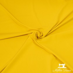 Tissu jersey uni X10cm - jaune or  - 1Tissu jerseyuni - jaune or 92% coton 8% élasthanne Laize d'1m50 - certifié OekoTex Le tis
