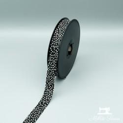 Biais à petits points  - noir  - 1Biaisà petits points blancs - noir 100% coton Largeur : 20 mm  1 unité = 0m50 ; pour plusieu