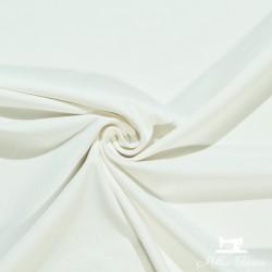 Tissu jersey uni X10cm - écru  - 1Tissu jerseyuni -écru 92% coton 8% élasthanne Laize d'1m50 - certifié OekoTex Le tissu est v