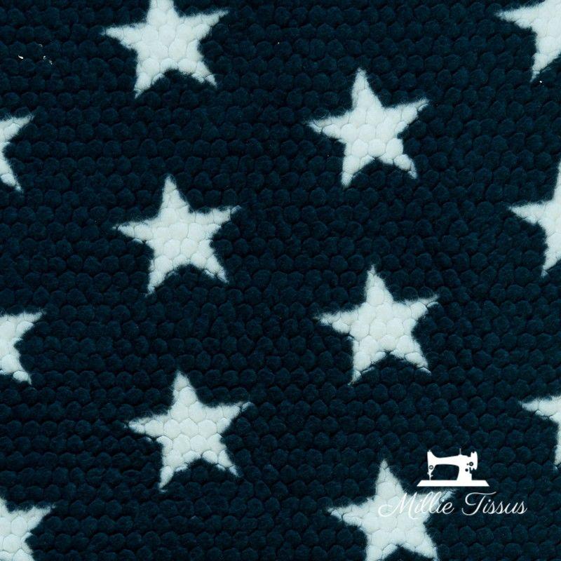 Tissu doudou toison étoiles  X10cm - marine  - 1Tissu doudou toison étoiles -Marine 100% polyester Laize d'1m50 Le tissu est ve