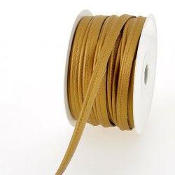 Passepoil simili cuir - doré  - 1Passepoil simili cuir 100% polyuréthane couleur doré Largeur : 10 mm 1 unité = 0m50 ; pour plus