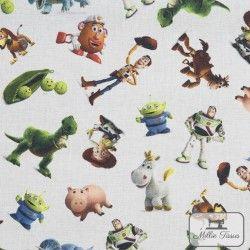 Tissu coton Toy Story 3 X10cm - blanc  - 1Tissucoton Toy Story 3 - Blanc 100% coton - Bio certifié GOTS et OekoTex Laize d'1m50