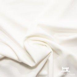 Tissu crêpe épais uni X10cm - Blanc cassé  - 1Tissucrêpe épais- blanc cassé 95% polyester - 5% élasthanne Certifié OekoTex L
