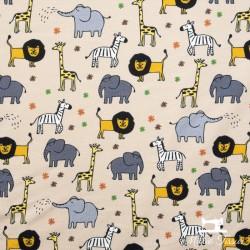 Tissu jersey animaux de la savane X10cm -  Beige  - 1Tissu jerseyanimaux de la savane - Beige 95% coton - 5% élasthanne Hauteu