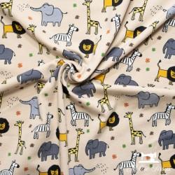 Tissu jersey animaux de la savane X10cm -  Beige  - 4Tissu jerseyanimaux de la savane - Beige 95% coton - 5% élasthanne Hauteu
